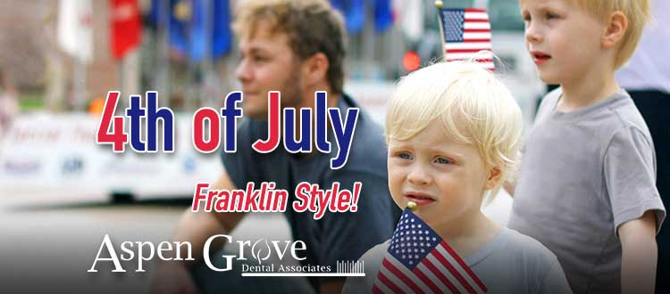 Aspen Grove Dental Blog image: Family watching 4th of July Parade